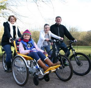 Ella on her duet bike - with family