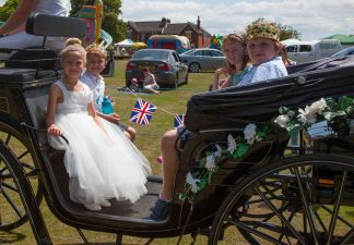 The carnival royalty in their carriage